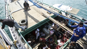 Iranian asylum seekers who were caught in Indonesian waters while sailing to Australia sit on a boat at Benoa port in Bali, Indonesia on May 12, 2013. (AP / Firdia Lisnawati)