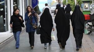 Iranian women make their way along a sidewalk in downtown Tehran, Iran, Tuesday, April 26, 2016. (AP / Vahid Salemi)