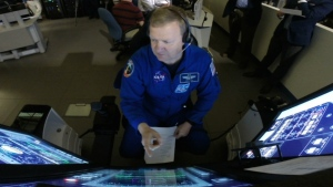 NASA astronaut Eric Boe uses the Crew Part-Task Trainer, a touch-screen simulator, during a training session at The Boeing Company's Defense, Space & Security division in St. Louis on Tuesday, April 26, 2016. (AP / Alex Sanz)