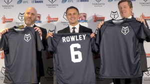 Eric Perez, the founder and CEO of the Toronto Wolfpack (left), Wolfpack head coach Paul Rowley and Toronto Mayor John Tory hold up jerseys of the new rugby league team in Toronto, on April 27, 2016. (Neil Davidson / THE CANADIAN PRESS)