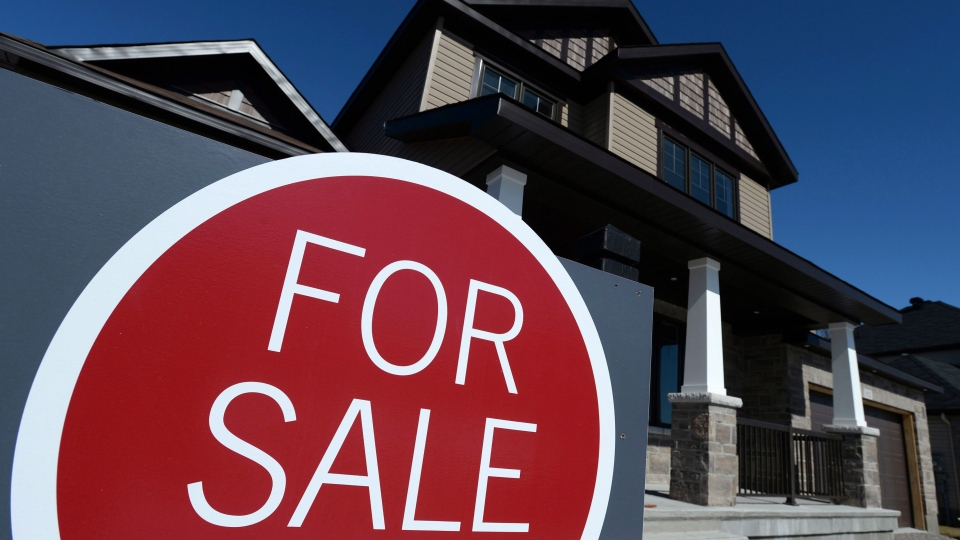 A sign advertises a new home for sale in Carleton Place, Ont., on March 17, 2015. (THE CANADIAN PRESS/Sean Kilpatrick)