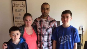 Riley Nault is shown with his family in this file image.