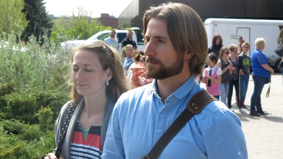 David and Collet Stephan come out of the courthouse in Lethbridge, Alta., on Saturday, April 23, 2016. (Bill Graveland / THE CANADIAN PRESS)