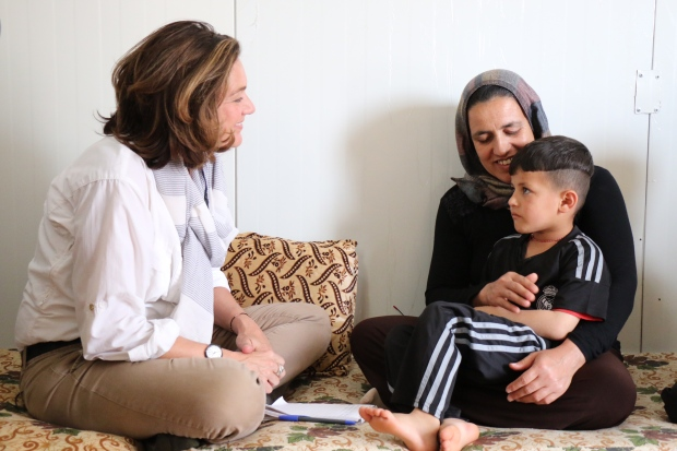 Lisa LaFlamme talks to Hanif in a refugee camp