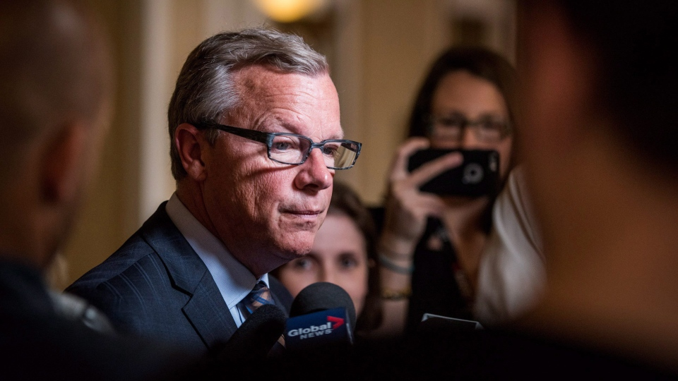 Saskatchewan Premier Brad Wall addresses press after meeting with Prime Minister Justin Trudeau in Saskatoon on Wednesday, April 27, 2016. THE CANADIAN PRESS/Matt Smith