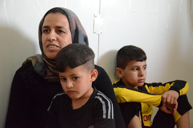 CTV News Chief Anchor and Senior Editor Lisa LaFlamme speaks to Hanif and her sons in the Qadiya refugee camp, located in northern Iraq, on Wednesday, April 27, 2016. (Bruce Campion-Smith / The Toronto Star)