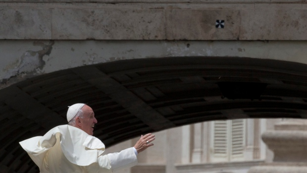 Pope Francis waives as he leaves his weekly general audience in St. Peter's Square at the Vatican, Wednesday, April 27, 2016. (AP Photo/Alessandra Tarantino)