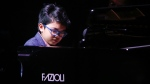 Joey Alexander performs at The Apollo Theater in New York, on Oct. 24, 2014. (Mark Von Holden / Invision / AP)