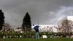 A rainbow appears over Paisley Park near a memorial for Prince in Chanhassen, Minn. on April 21, 2016. (Carlos Gonzalez / Star Tribune)