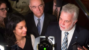 Quebec Premier Philippe Couillard, right, speaks to reporters at the legislature in Quebec City on April 28, 2016. (Jacques Boissinot / THE CANADIAN PRESS)
