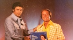 Philip Kives (left) is seen with singer Pat Boone in this undated photo from K-tel International's website.