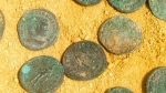 This photo made available by the City Council of Tomares on Friday, April 29, 2016, shows some of the bronze and silver-coated coins dating from the end of the 4th century. (City Council of Tomares via AP)