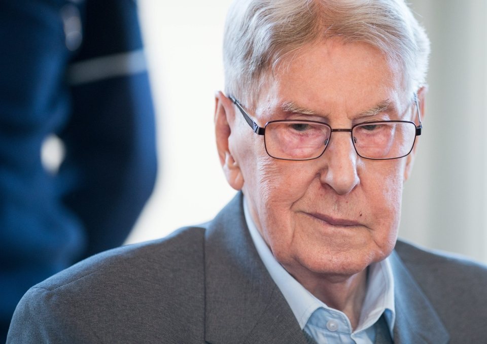94-year-old former SS sergeant Reinhold Hanning sits in the courtroom in Detmold, Germany, Friday, April 29, 2016. Henning's trial opened in February on 170,000 counts of accessory to murder over allegations he served as a guard at the Nazis' Auschwitz death camp. (Bernd Thissen/Pool Photo via AP)