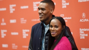 """Parker Sawyers, left, and Tika Sumpter, who play Barack Obama and Michelle Obama in """"Southside With You,"""" pose together at the premiere of the film at the 2016 Sundance Film Festival on Sunday, Jan. 24, 2016, in Park City, Utah. (Photo by Chris Pizzello/Invision/AP)"""