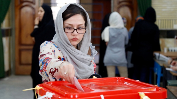 An Iranian woman casts her ballot for the parliamentary runoff elections in a polling station at the city of Qods about 20 kilometers west of the capital Tehran, Iran, Friday, April 29, 2016. (AP Photo)