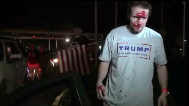 Image from video shows a supporter of Republican presidential candidate Donald Trump after a protest in Costa Mesa, Calif., on April 28, 2016. (APTN via AP Photo)