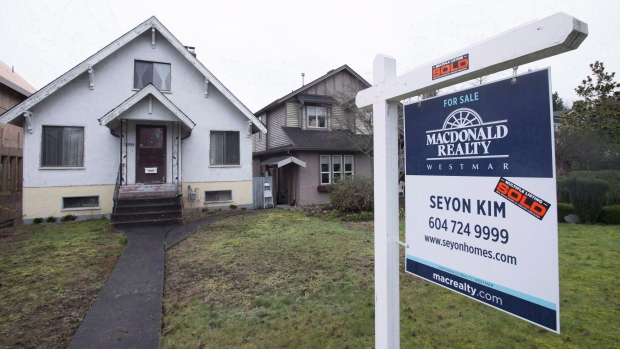 A sold home is pictured in Vancouver, B.C., Thursday, Feb. 11, 2016. (THE CANADIAN PRESS/Jonathan Hayward)