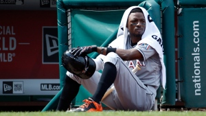 Miami Marlins second baseman Dee Gordon sits on the edge of the dugout at Nationals Park, in Washington on Aug. 30, 2015.  (Alex Brandon / AP)
