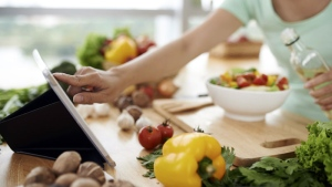 A new report from Google shows many of us do web searches while cooking and eating. (DragonImages/Istock.com)