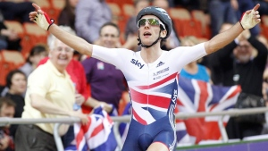 In this Friday Feb. 22, 2013 file photo, Britain's Simon Yates celebrates after winning the track cycling men's Points Race event during the Track Cycling World Championships in Minsk, Belarus. (AP Photo/Mindaugas Kulbis, File)