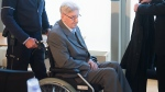 94-year-old former SS sergeant Reinhold Hanning arrives in the courtroom in Detmold, Germany, Friday, April 29, 2016. (Bernd Thissen / Pool Photo via AP)