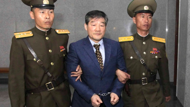 Kim Dong Chul, center, a U.S. citizen detained in North Korea, is escorted to his trial Friday, April 29, 2016, in Pyongyang, North Korea. (AP Photo / Kim Kwang Hyon)
