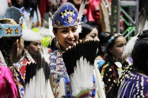 Nearly 3,000 indigenous dancers from across the United States and other countries participate in the first grand entry of the 33rd annual Gathering of Nations in Albuquerque, N.M., on April 29, 2016. (Susan Montoya Bryan / AP Photo)