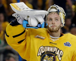 Quinnipiac goalie Michael Garteig spits water after giving up a goal to North Dakota during the third period of an NCAA Frozen Four championship college hockey game on April 9, 2016, in Tampa, Fla. (Chris O'Meara / AP Photo)