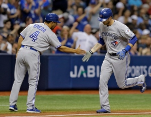 Toronto Blue Jays' Michael Saunders, right, shakes hands with third base coach Luis Rivera after hitting a home run off Tampa Bay Rays starting pitcher Drew Smyly during the third inning of a baseball game on April 29, 2016, in St. Petersburg, Fla. (Chris O'Meara / AP Photo)