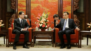 Japanese Foreign Minister Fumio Kishida, left, talks with China's Premier Li Keqiang during a meeting at the Zhongnanhai leadership compound in Beijing Saturday, April 30, 2016. (Jason Lee/Pool Photo via AP)