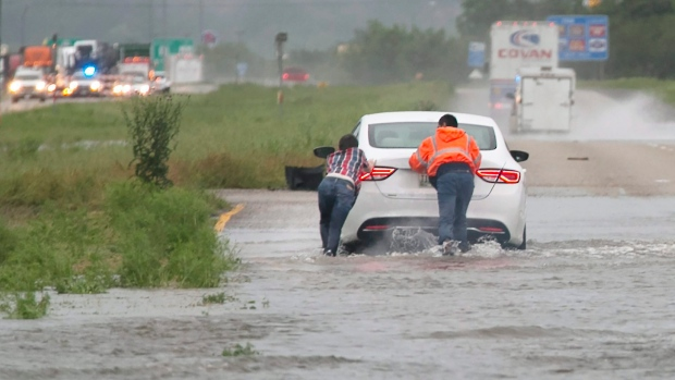 Heavy rains caused portions of Texas State Highway 71 East to flood, giving motorists the option to wade through the low areas or turn around just west of LaGrange, Texas, Monday, April 18, 2016. (Ralph BarreraAustin American-Statesman via AP)