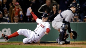 Boston Red Sox's Brock Holt slides in to score on a double by Jackie Bradley Jr. as New York Yankees catcher Brian McCann waits for the throw during the seventh inning of a baseball game at Fenway Park on Friday, April 29, 2016, in Boston. (AP / Elise Amendola)