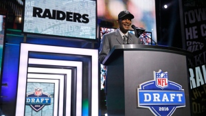 Former NFL player Willie Brown announces that the Oakland Raiders selects Illinois' Jihad Ward as the 44th pick in the second round of the 2016 NFL football draft, Friday, April 29, 2016, in Chicago. (AP / Charles Rex Arbogast)
