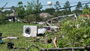 Household items and debris are scattered along land between houses on Farm-to-Market 16 in Lindale, Texas, Saturday, April, 30, 2016 after severe weather including a possible tornado Friday night. (Sarah A. Miller/Tyler Morning Telegraph)