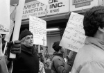 This April 9, 1982, file photo shows Daniel Berrigan marching with about 40 others outside of the Riverside Research Center in New York. (AP / Marty Lederhandler)