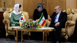 South Korean President Park Geun-hye, left, listens to Iranian Industry Minister Mohammad Reza Nematzadeh upon her arrival at Mehrabad Airport in Tehran, Iran, Sunday, May 1, 2016.  (AP Photo / Vahid Salemi)