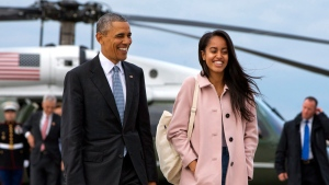 In a Thursday, April 7, 2016 file photo, President Barack Obama jokes with his daughter Malia Obama as they walk to board Air Force One from the Marine One helicopter, as they leave Chicago en route to Los Angeles. (AP / Jacquelyn Martin, File)
