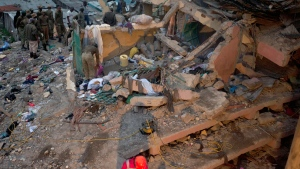 Debris is seen at the site of a building collapse in Nairobi, Kenya, Saturday, April 30, 2016. A six-story residential building in a low income area of the Kenyan capital collapsed Friday under heavy rain and flooding, trapping an unknown number of people in the rubble, Kenyan officials said.(AP / Sayyid Abdul Azim)