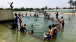 Supporters of Shiite cleric Muqtada al-Sadr swim in a fountain during their sit-in inside Baghdad's highly fortified Green Zone Sunday, May 1, 2016. (AP / Karim Kadim)