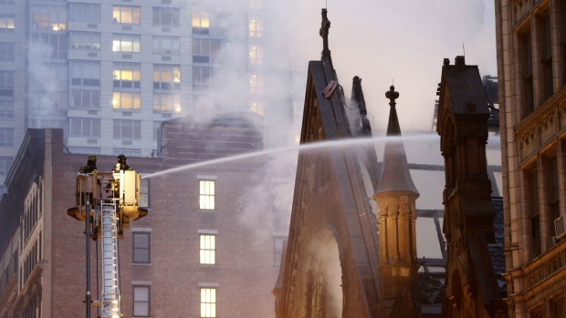 Firefighters battle flames at the historic Serbian Orthodox Cathedral of St. Sava in New York on Sunday, May 1, 2016. (AP / Kathy Willens)