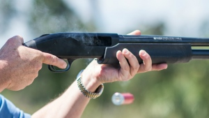 Jonathan Mossberg, whose iGun Technology Corp. is working to develop a 'smart gun,' demonstrates the firearm, in Daytona Beach, Fla. on April 7, 2016. (AP / Lisa Marie Pane)