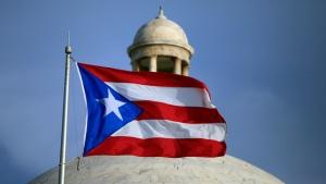 The Puerto Rican flag flies in front of Puerto Rico's Capitol in San Juan, Puerto Rico, on July 29, file 2015. (Ricardo Arduengo / AP)