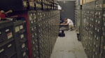 'New York Times' morgue manager Jeff Roth looks through a drawer of index cards. The morgue is where all of the paper's clippings, photos, microfilm, books and other archival materials are kept. (Green Fuse Films)