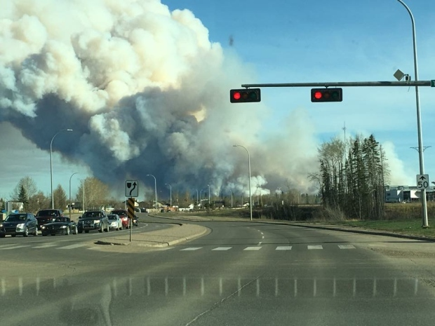 A fire burns in Fort McMurray, Alta., Sunday, May 1, 2016. (Joshua Duclos / MyNews)