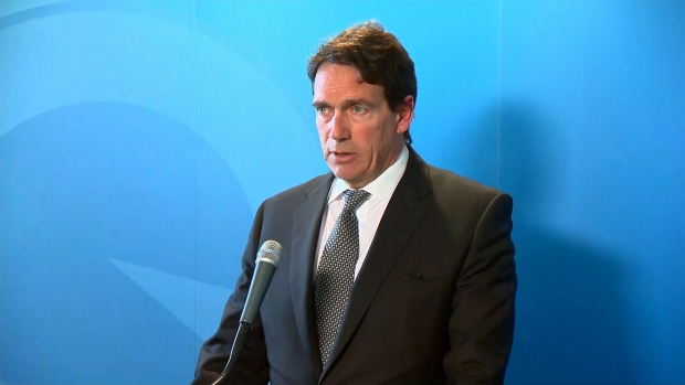 Pierre Karl Peladeau announces he is stepping down as PQ leader during a press conference, Monday, May 2, 2016.
