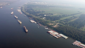 This Friday, Sept. 2, 2005 file photo shows ships and cargo containers along the Mississippi River in this aerial view, between Baton Rouge and New Orleans. (AP Photo / David J. Phillip, Pool, File)
