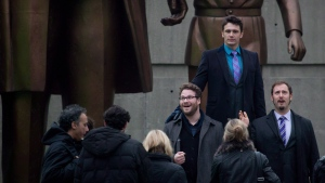"""Seth Rogen, James Franco and Evan Goldberg, right, pose for a photograph during filming of """"The Interview"""" at Robson Square in Vancouver, B.C., on Friday, Nov. 29, 2013. (THE CANADIAN PRESS/Darryl Dyck)"""
