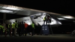 Pilot Andre Borschberg sits in the cockpit of the Solar Impulse 2, as his son, Teo Borschberg, prepares the solar powered plane at Moffett Field in Mountain View, Calif., before dawn on Monday, May 2, 2016. (Karl Mondon / The Mercury News-Bay Area News Group)