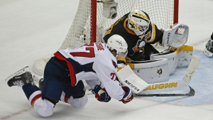 Washington Capitals T.J. Oshie tries to slide the puck past Pittsburgh Penguins goalie Matt Murray during the third period of Game 3 in an NHL hockey Stanley Cup Eastern Conference semifinals in Pittsburgh on Monday, May 2, 2016. (AP / Gene J. Puskar)
