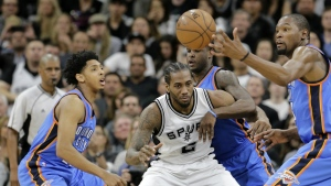 Oklahoma City Thunder's Cameron Payne, left, Dion Waiters, rear, and Kevin Durant, right, combine to strip the ball from San Antonio Spurs forward Kawhi Leonard during the first half in Game 2 of a second-round NBA basketball playoff series in San Antonio on Monday, May 2, 2016. (AP / Eric Gay)